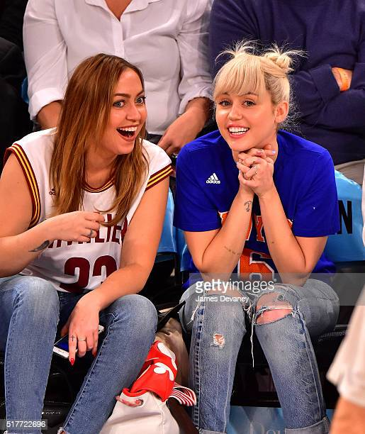 Brandi Cyrus and Miley Cyrus attend the Cleveland Cavaliers vs New York Knicks game at Madison Square Garden on March 26 2016 in New York City