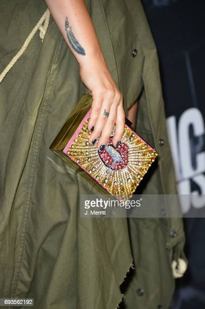 Brandi Cyrus purse detail attends the 2017 CMT Music Awards at the Music City Center on June 7 2017 in Nashville Tennessee
