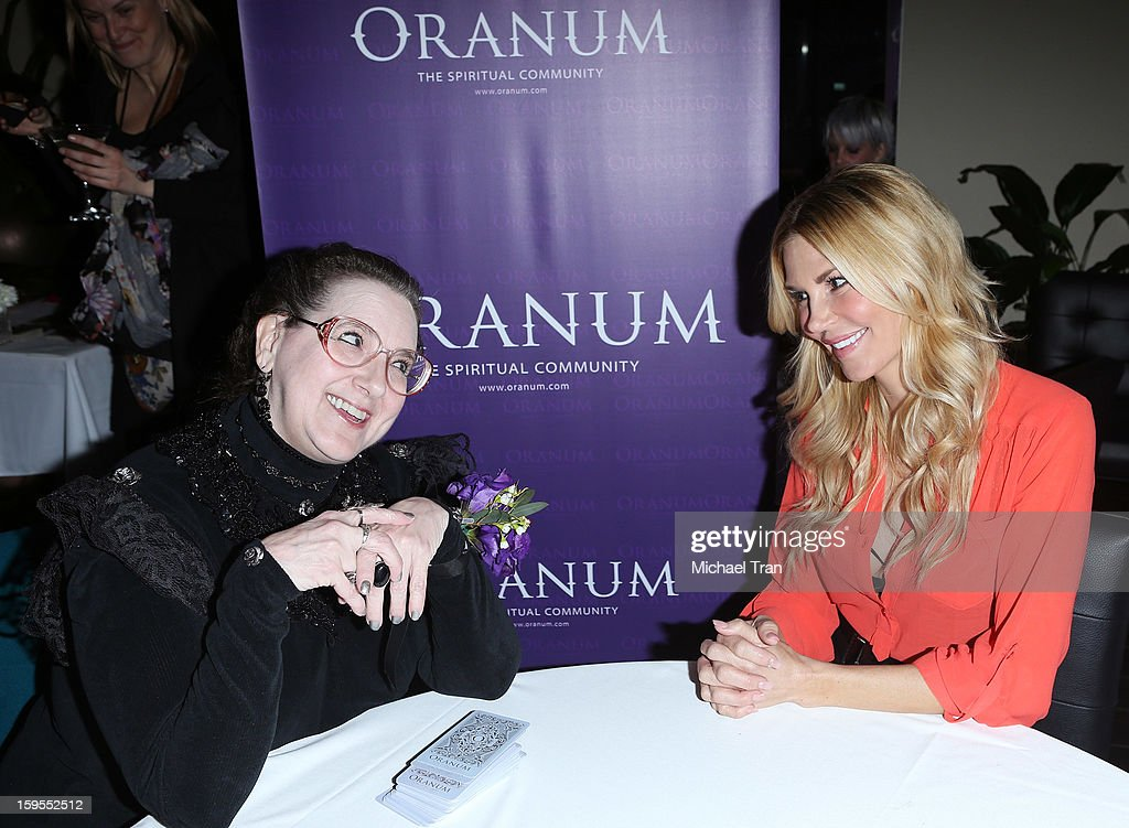 <a gi-track='captionPersonalityLinkClicked' href=/galleries/search?phrase=Brandi+Glanville&family=editorial&specificpeople=841250 ng-click='$event.stopPropagation()'>Brandi Glanville</a> (R) gets a psychic reading at the 'How Lavish Will Your 2013 Be?' event held at Sur Restaurant on January 15, 2013 in Los Angeles, California.
