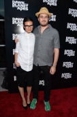 Brandi Milbradt and director Darren Aronofsky attend the 'Dawn Of The Planets Of The Apes' premiere at Williamsburg Cinemas on July 8 2014 in New...