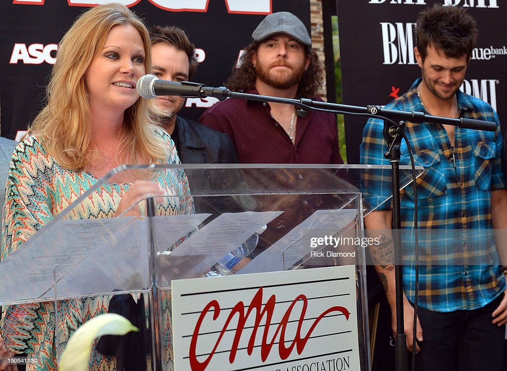 Brandi Simms CMA (pictured) Songwriter Will Hoge (BMI) and Songwriter Eric Paslay (ASCAP) are honored for there #1 hit 'Even if it breaks your heart' recorded by Republic Nashville recording artists Eli Young Band at the CMA offices on August 20, 2012 in Nashville, Tennessee.