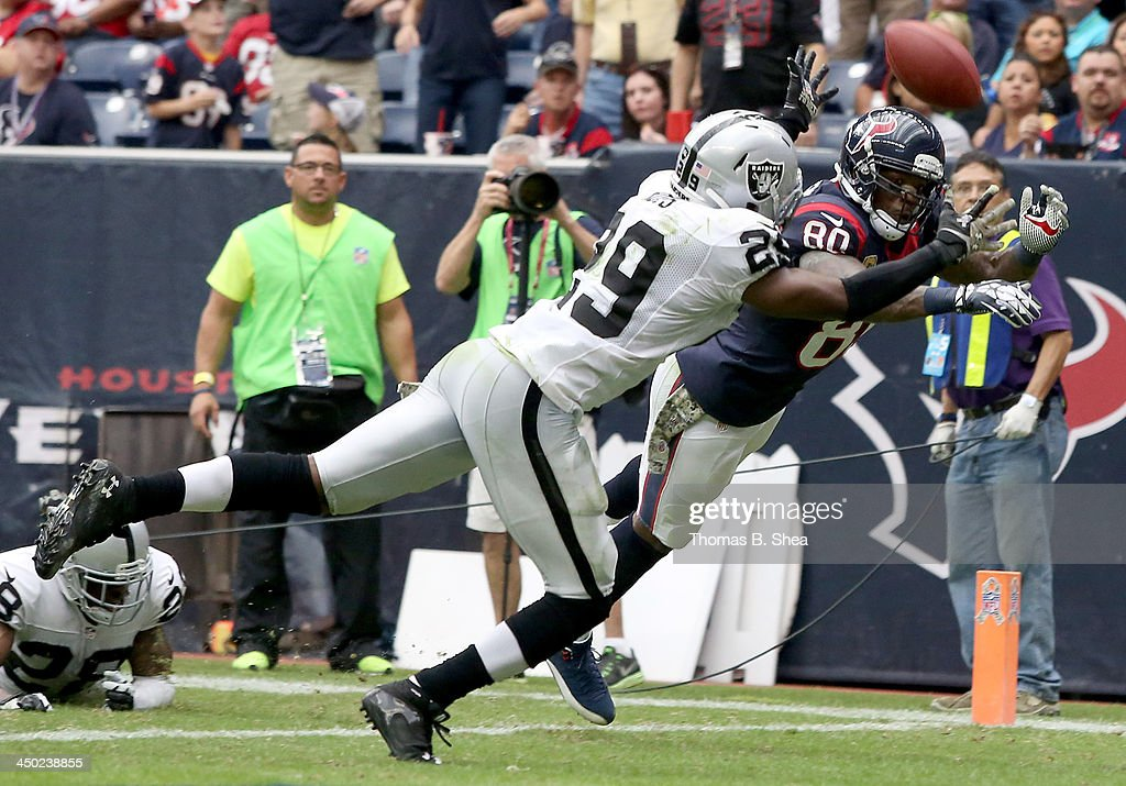 Brandian Ross #29 of the Oakland Raiders breaks up a pass intended for Andre Johnson #80 of the Houston Texans on November 17, 2013 at Reliant Stadium in Houston, Texas.
