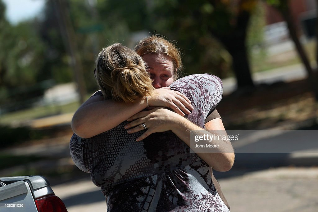 Brandie Barbiere (R) embraces a family member as an eviction team removes her family's possessions from her house during a home foreclosure on October 5, 2011 in Milliken, Colorado. Barbiere said she had stopped making the mortgage payments 11 months before, after she lost more than half her home child care business due to the continued weak economy. A nationwide glut of foreclosed homes is expected to depress U.S. housing values for years.