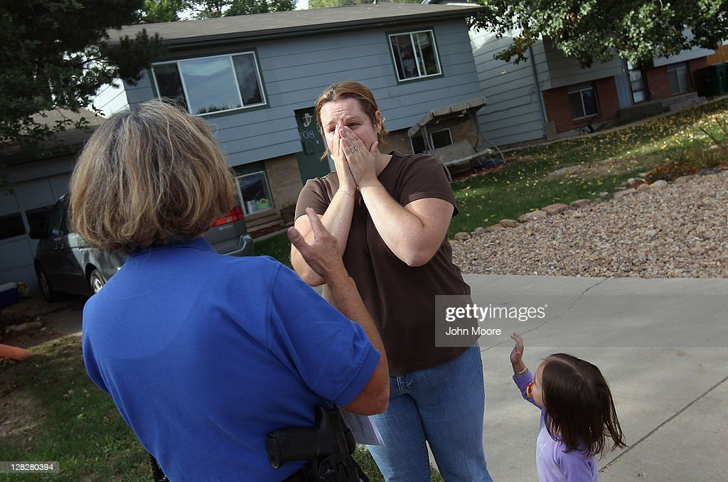 Brandie Barbiere (C) reacts as Weld County sheriff's deputy Mary Schwartz (L) arrives to evict her and her family from their home on October 5, 2011 in Milliken, Colorado. Barbiere said she had stopped making the mortgage payments 11 months before, after she lost more than half her home child care business due to the economy. The Barbiere family's possessions were removed to the front yard by an eviction team and the door locks changed. A nationwide glut of foreclosed homes is expected to depress U.S. housing values for years.
