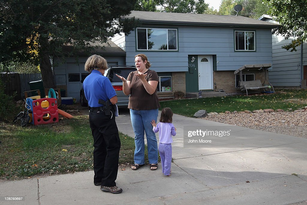 Brandie Barbiere reacts as Weld County sheriff's deputy Mary Schwartz arrives to evict her and her family from their home on October 5, 2011 in Milliken, Colorado. Barbiere said she had stopped making the mortgage payments 11 months before, after she lost more than half her home child care business due to the poor economy. The Barbiere family's possessions were removed to the front yard by an eviction team and the door locks changed. A nationwide glut of foreclosed homes is expected to depress U.S. housing values for years.