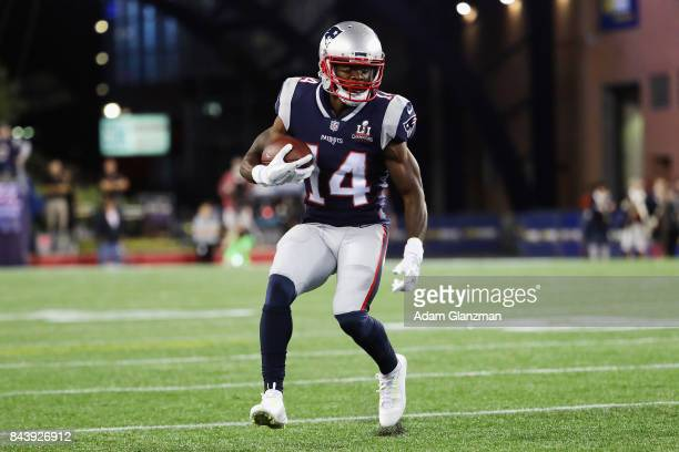 Brandin Cooks of the New England Patriots runs with the ball during the first half against the Kansas City Chiefs at Gillette Stadium on September 7...