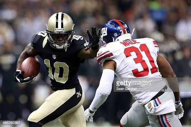 Brandin Cooks of the New Orleans Saints avoids a tackle by Trevin Wade of the New York Giants during the first quarter of a game at the MercedesBenz...