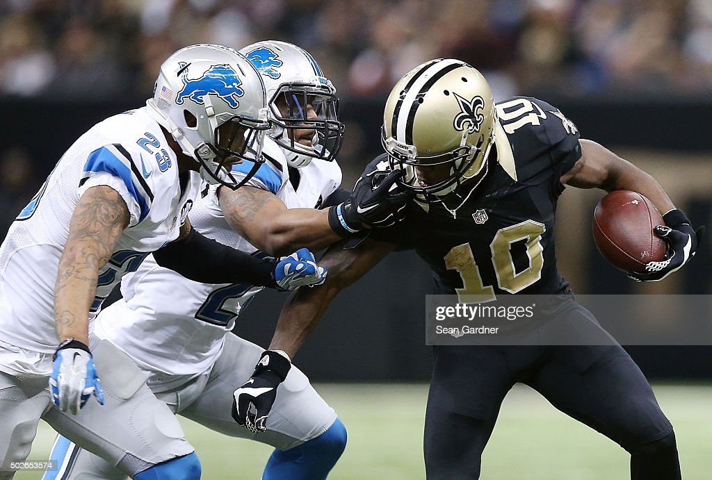 Brandin Cooks #10 of the New Orleans Saints breaks a tackle againts the Detroit Lions at the Mercedes-Benz Superdome on December 21, 2015 in New Orleans, Louisiana.
