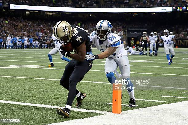 Brandin Cooks of the New Orleans Saints catches a pass for a touchdown in front of Nevin Lawson of the Detroit Lions during the third quarter of a...