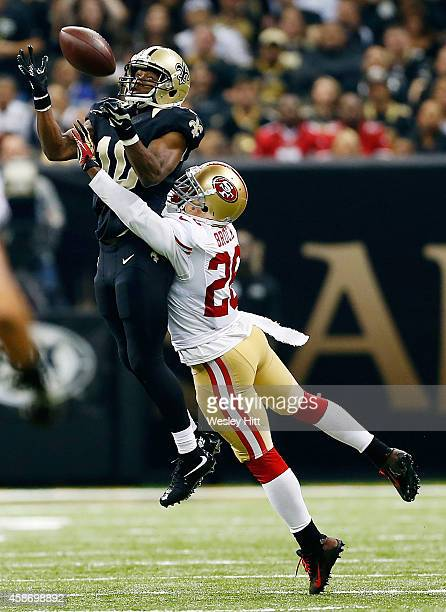 Brandin Cooks of the New Orleans Saints catches a pass in front of Tramaine Brock of the San Francisco 49ers during the second quarter of a game at...