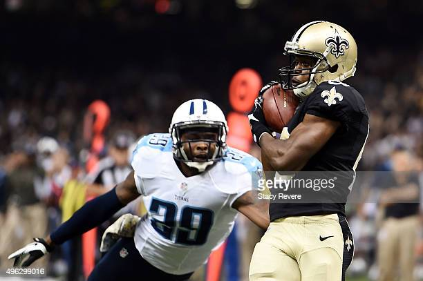 Brandin Cooks of the New Orleans Saints catches a touchdown in front of Daimion Stafford of the Tennessee Titans during the first quarter of a game...