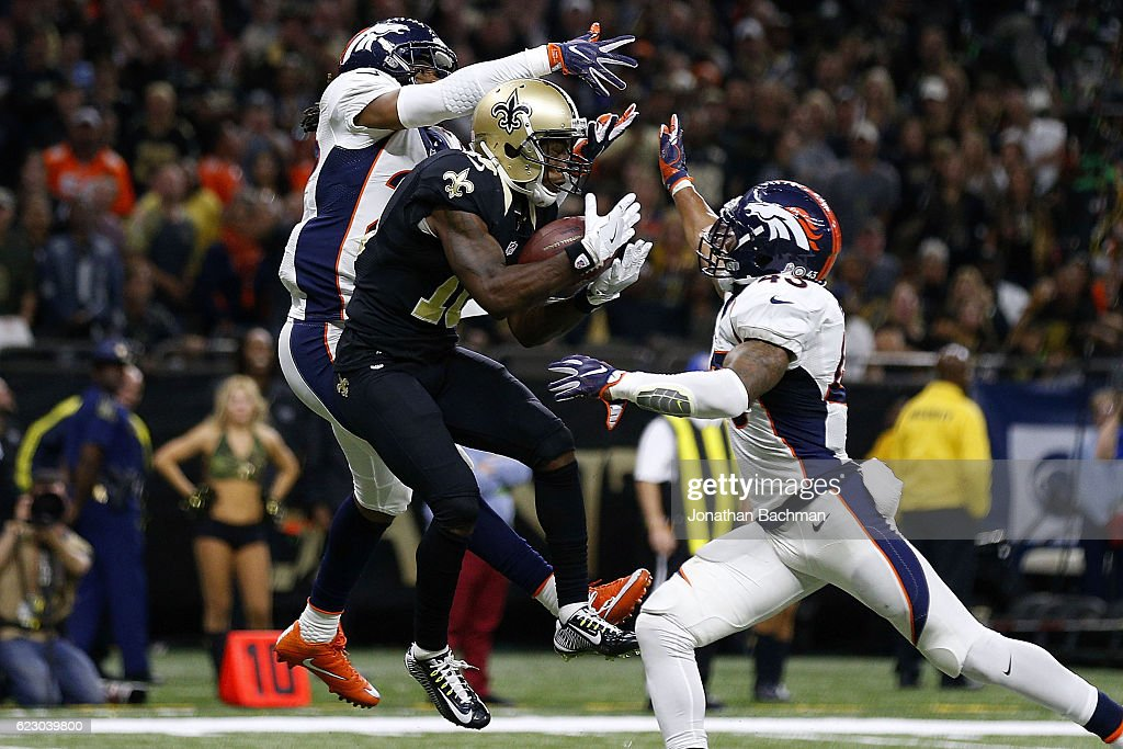 Brandin Cooks #10 of the New Orleans Saints catches a touchdown over T.J. Ward #43 of the Denver Broncos and Bradley Roby #29 during the second half of a game at the Mercedes-Benz Superdome on November 13, 2016 in New Orleans, Louisiana.