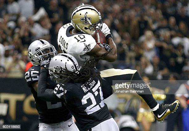 Brandin Cooks of the New Orleans Saints catches the ball for a touchdown over Reggie Nelson of the Oakland Raiders and DJ Hayden during the first...