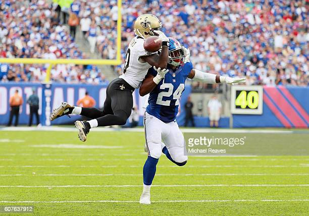 Brandin Cooks of the New Orleans Saints fights to catch a pass against Eli Apple of the New York Giants during the second half at MetLife Stadium on...