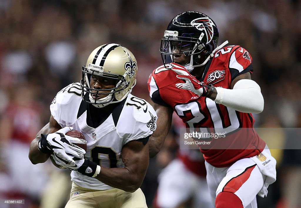 Brandin Cooks #10 of the New Orleans Saints is pursued by Phillip Adams #20 of the Atlanta Falcons during the fourth quarter of a game at the Mercedes-Benz Superdome on October 15, 2015 in New Orleans, Louisiana.