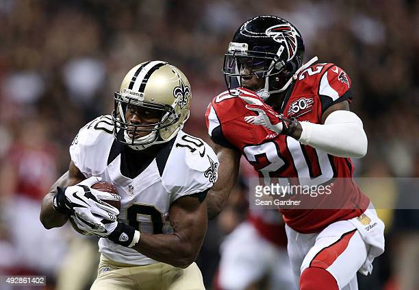 Brandin Cooks of the New Orleans Saints is pursued by Phillip Adams of the Atlanta Falcons during the fourth quarter of a game at the MercedesBenz...