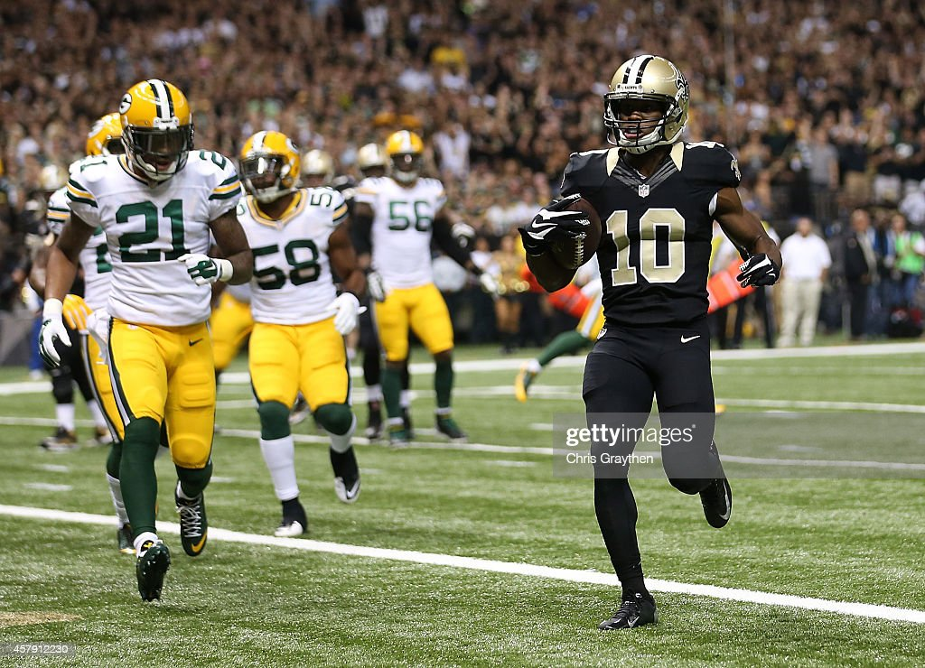 Brandin Cooks #10 of the New Orleans Saints runs the ball in for a touchdown against the Green Bay Packers during the first quarter at Mercedes-Benz Superdome on October 26, 2014 in New Orleans, Louisiana.