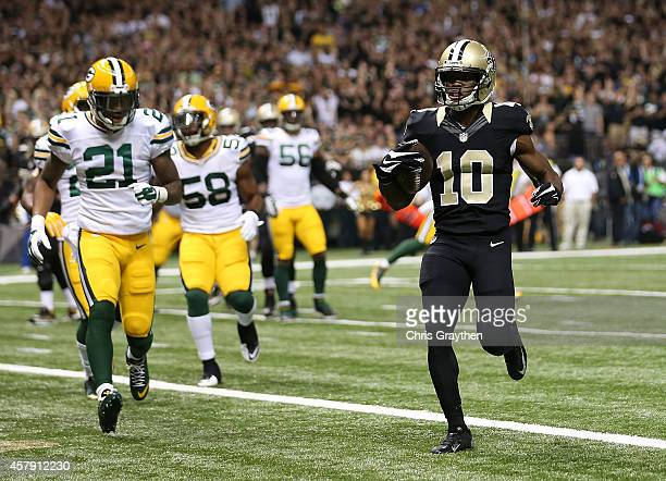 Brandin Cooks of the New Orleans Saints runs the ball in for a touchdown against the Green Bay Packers during the first quarter at MercedesBenz...