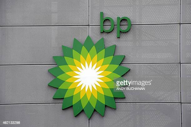 Branding is seen on the walls at the headquarters of BP in Aberdeen Scotland on January 21 2015 On the docks in Aberdeen oil workers put a brave face...