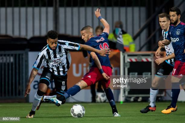 Brandley Kuwas of Heracles Almelo Hakim Ziyech of Ajax during the Dutch Eredivisie match between Heracles Almelo and Ajax Amsterdam at Polman stadium...