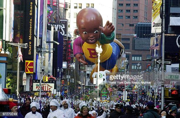 Brandnew balloon Little Bill waves at crowd as he floats through Times Square during the 76th annual Macy's Thanksgiving Day Parade Little Bill the...