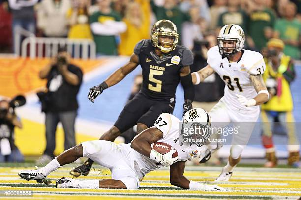 Brandon Alexander of the UCF Knights intercepts a pass in the second quarter against Antwan Goodley of the Baylor Bears during the Tostitos Fiesta...