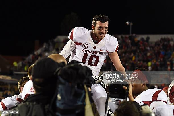 Brandon Allen of the Arkansas Razorbacks is carried off the field by his teammates following an overtime victory over the Mississippi Rebels at...