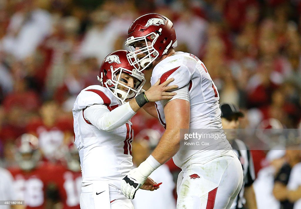 Brandon Allen #10 of the Arkansas Razorbacks reacts after passing for a touchdown against the Alabama Crimson Tide with Dan Skipper #70 at Bryant-Denny Stadium on October 10, 2015 in Tuscaloosa, Alabama.