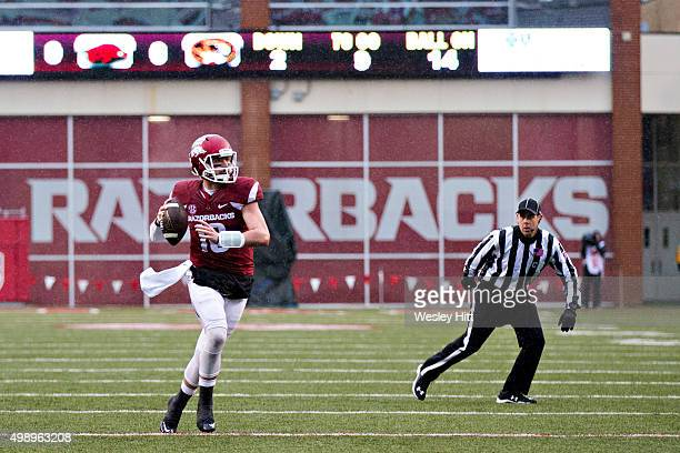 Brandon Allen of the Arkansas Razorbacks rolls out to pass during a game against the Missouri Tigers at Razorback Stadium Stadium on November 27 2015...