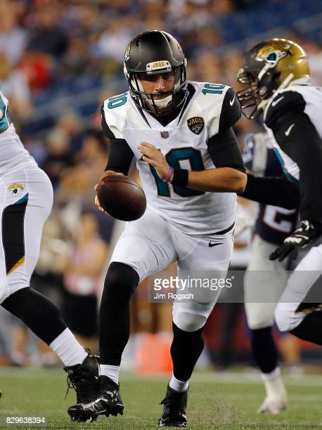 Brandon Allen of the Jacksonville Jaguars prepares to hand the ball off against the New England Patriots in the second half during a preseason game...