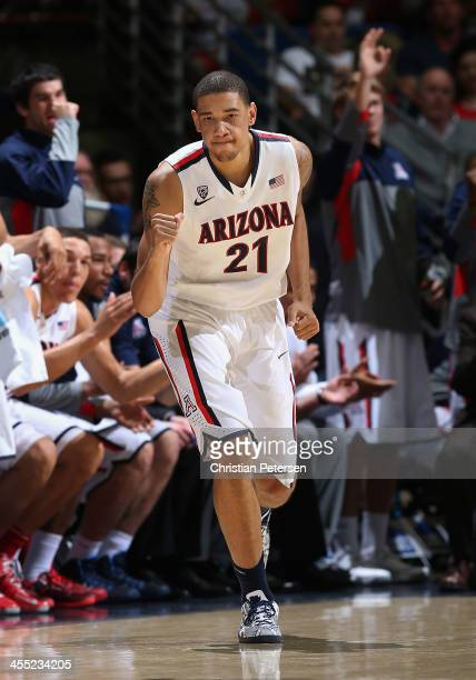 Brandon Ashley of the Arizona Wildcats celebrates after hitting a three point shot against the New Mexico State Aggies during the second half of the...