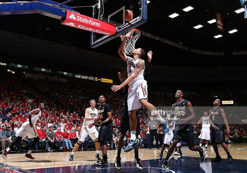 Brandon Ashley #21 of the Arizona Wildcats puts up a shot against the Long Beach State 49ers during the second half of the college basketball game at McKale Center on November 19, 2012 in Tucson, Arizona. The Wildcats defeated the 49ers 94-72.