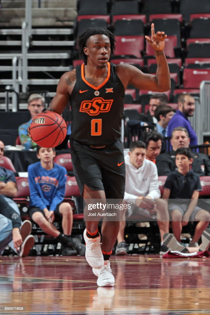 Brandon Averette #0 of the Oklahoma State Cowboys brings the ball up court against the Florida State Seminoles during the MetroPCS Orange Bowl Basketball Classic on December 16, 2017 at the BB&T Center in Sunrise, Florida. Oklahoma State defeated Florida State 71-70.