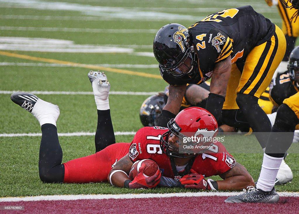 Brandon Banks of the Calgary Stampeders is stopped just short of the goal line against the Hamilton TigerCats in a CFL game at Ron Joyce Stadium on...