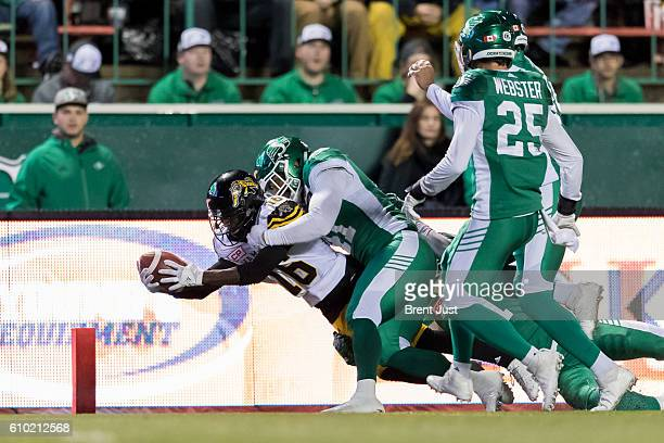 Brandon Banks of the Hamilton TigerCats falls across the goal line for a touchdown in first half action in the game between the Hamilton TigerCats...