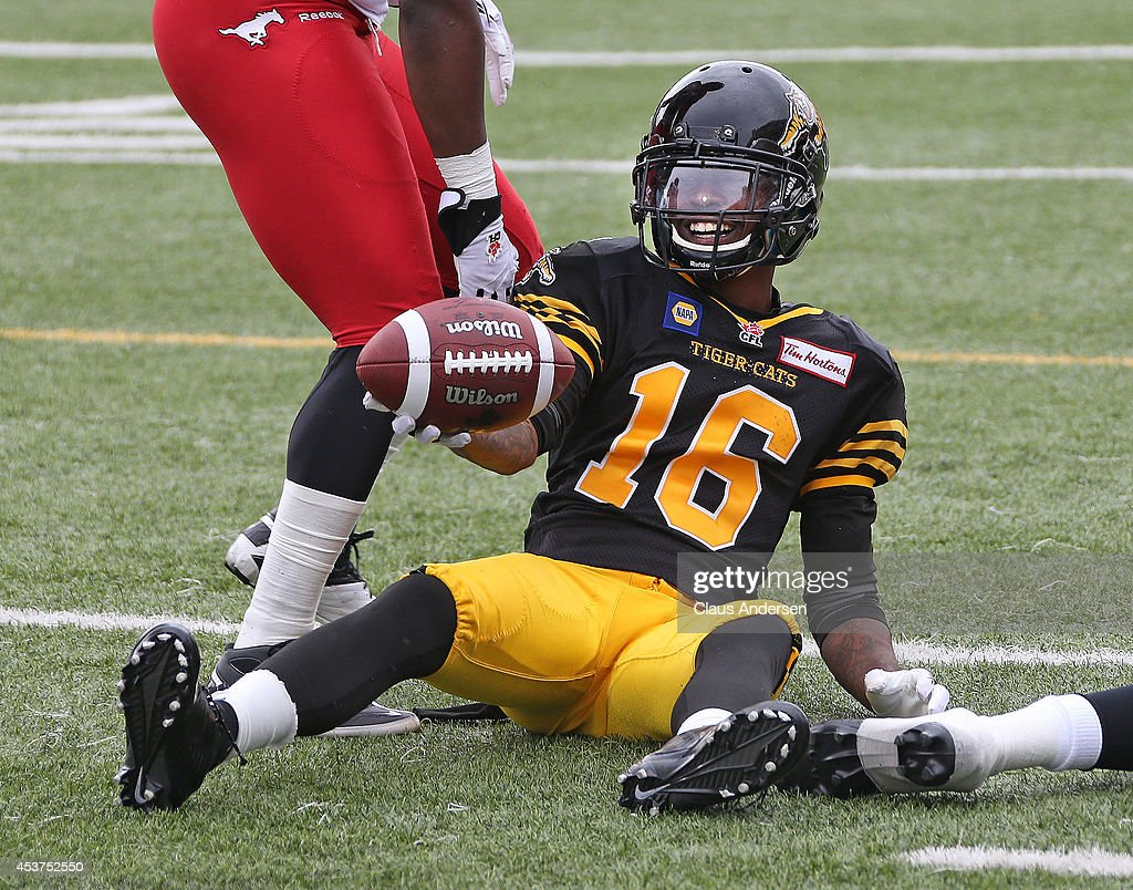 Brandon Banks of the Hamilton TigerCats seems pleased with a play against the Calgary Stampeders in a CFL game at Ron Joyce Stadium on August 16 2014...