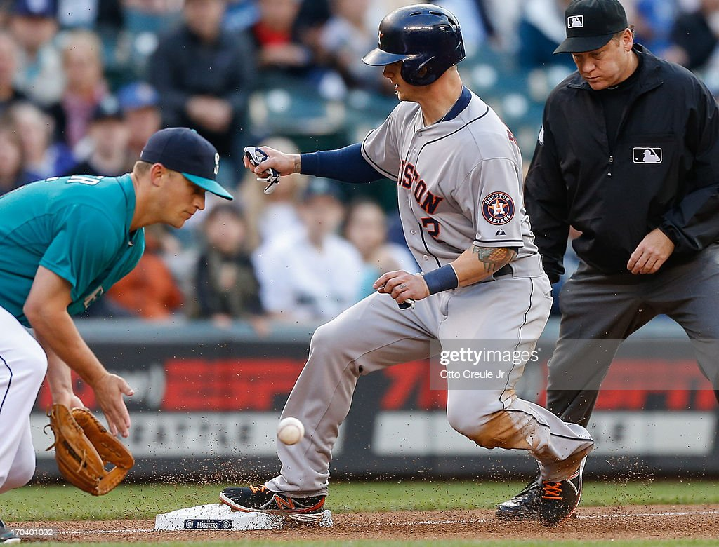Brandon Barnes #2 of the Houston Astros advances to third from second against third baseman Kyle Seager #15 of the Seattle Mariners on a fly ball out by Marwin Gonzalez in the third inning at Safeco Field on June 12, 2013 in Seattle, Washington.