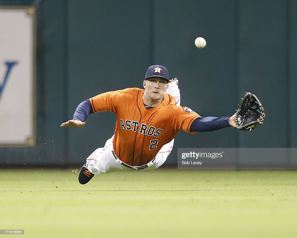 Brandon Barnes #2 of the Houston Astros makes a diving catch on a line drive by J.B. Shuck (not pictured) of the Los Angeles Angels in the third inning at Minute Maid Park on June 28, 2013 in Houston, Texas.