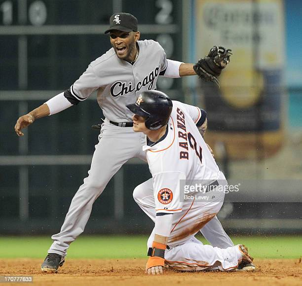 Brandon Barnes of the Houston Astros steals second base in the fifth inning as Alexei Ramirez of the Chicago White Sox is late on the tag at Minute...