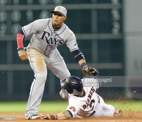 Brandon Barnes of the Houston Astros takes second base on a ball four count on the batter as Yunel Escobar of the Tampa Bay Rays awaited the throw at...