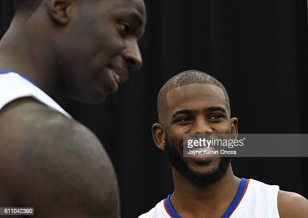 Brandon Bass and Chris Paul of the Los Angeles Clippers talk during media day at the Los Angeles Clippers Training Center on September 26 2016 in...