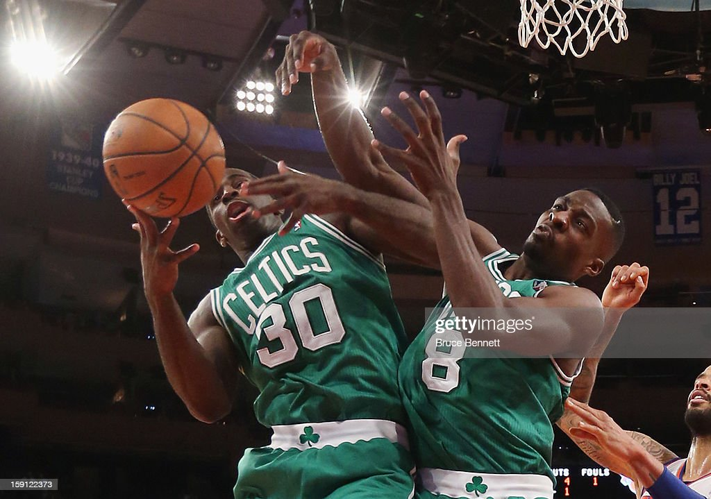 Brandon Bass #30 and Jeff Green #8 of the Boston Celtics grab a rebound against the New York Knicks at Madison Square Garden on January 7, 2013 in New York City.