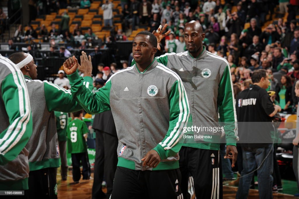 Brandon Bass #30 and Kevin Garnett #5 of the Boston Celtics walk onto the court before the game against the Houston Rockets on January 11, 2013 at the TD Garden in Boston, Massachusetts.