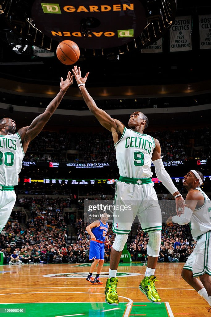 Brandon Bass #30 and Rajon Rondo #9 of the Boston Celtics reach for a rebound against the New York Knicks on January 24, 2013 at the TD Garden in Boston, Massachusetts.