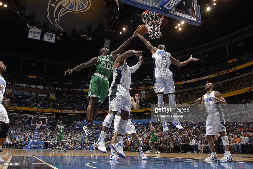 Brandon Bass #30 of the Boston Celtics and Moe Harkless #21 of the Orlando Magic battle for the ball control during the game between the Boston Celtics and the Orlando Magic on November 25, 2012 at Amway Center in Orlando, Florida.