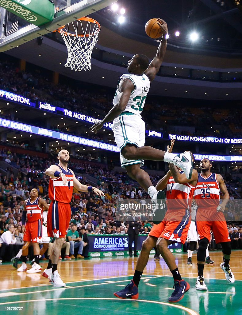 Brandon Bass #30 of the Boston Celtics attempts an alley-oop in the first quarter against the Washington Wizardsduring the game at TD Garden on December 21, 2013 in Boston, Massachusetts.