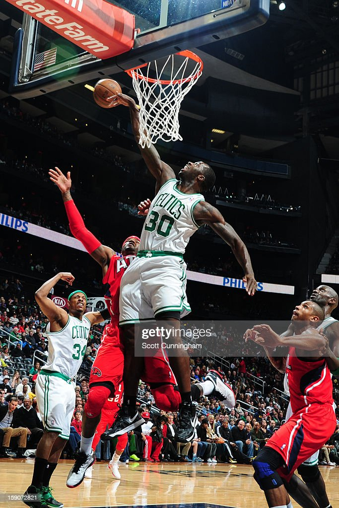 Brandon Bass #30 of the Boston Celtics attempts to block a shot by Josh Smith #5 of the Atlanta Hawks on January 5, 2013 at Philips Arena in Atlanta, Georgia.
