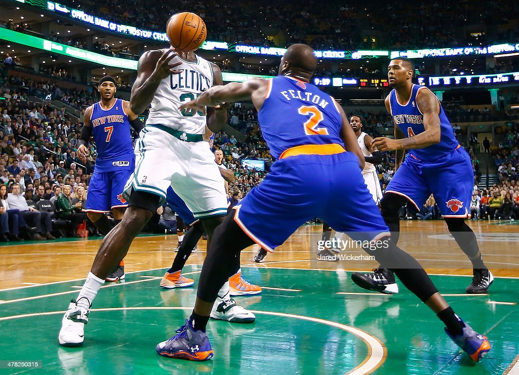 Brandon Bass #30 of the Boston Celtics attempts to grab a rebound in front of Raymond Felton #2 of the New York Knicks in the second half during the game at TD Garden on March 12, 2014 in Boston, Massachusetts.