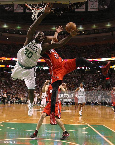 Brandon Bass of the Boston Celtics battles Jeff Teague of the Atlanta Hawks in the first quarter in Game Four of the Eastern Conference Quarterfinals...