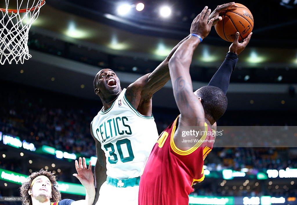 <a gi-track='captionPersonalityLinkClicked' href=/galleries/search?phrase=Brandon+Bass&family=editorial&specificpeople=233806 ng-click='$event.stopPropagation()'>Brandon Bass</a> #30 of the Boston Celtics blocks the shot of <a gi-track='captionPersonalityLinkClicked' href=/galleries/search?phrase=Dion+Waiters&family=editorial&specificpeople=6902921 ng-click='$event.stopPropagation()'>Dion Waiters</a> #3 of the Cleveland Cavaliers in the final seconds of the fourth quarter during the game at TD Garden on December 28, 2013 in Boston, Massachusetts.